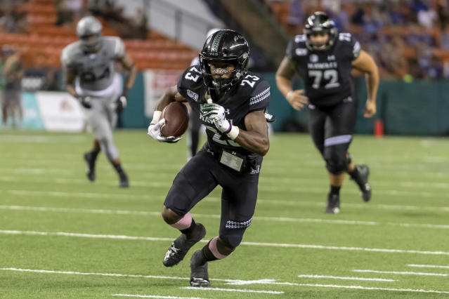 Hawaii wide receiver Jared Smart (23) runs with the football during the first half of an NCAA college football game against Air Force, Saturday, Oct. 19, 2019, in Honolulu. (AP Photo/Eugene Tanner)