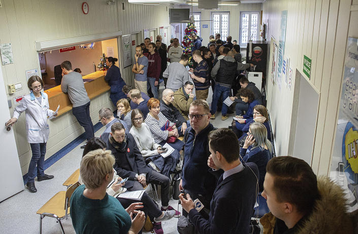 People line up to donate blood for Gdansk Mayor Adamowicz, who is in critical condition and needs blood transfusions after being stabbed in the heart and abdomen on stage during a charity event the evening before, in Gdansk, Poland, Monday Jan. 14, 2019. Doctors operated for five hours on Adamowicz after an ex-convict rushed onto the stage with a knife, carried out the attack and shouted it was political revenge against a political party Adamowicz previously belonged to. (Krzysztof Mystkowski / KFP via AP) POLAND AUT