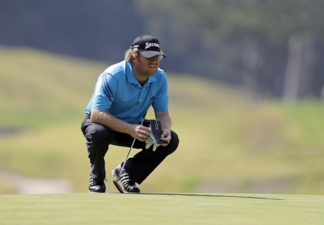 William McGirt looks over the eighth green during the third round of the Northern Trust Open golf tournament at Riviera Country Club in the Pacific Palisades area of Los Angeles Saturday, Feb. 15, 2014. (AP Photo/Reed Saxon)