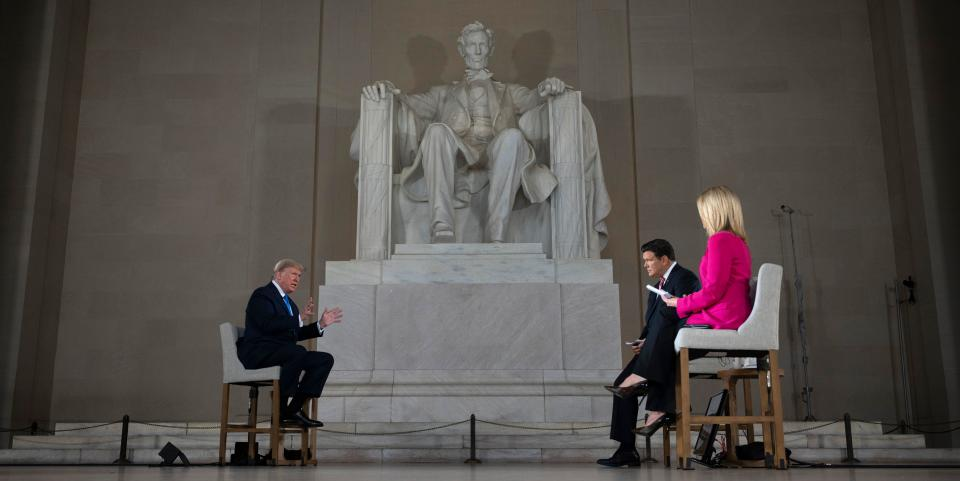 """US President Donald Trump speaks during a Fox News virtual town hall """"America Together: Returning to Work,"""" event, with anchors Bret Baier (2nd R) and Martha MacCallum (R), from the Lincoln Memorial in Washington, DC on May 3, 2020. - Trump will answer questions submitted by viewers on Twitter, Facebook and Instagram. (Photo by JIM WATSON / AFP) (Photo by JIM WATSON/AFP via Getty Images)"""