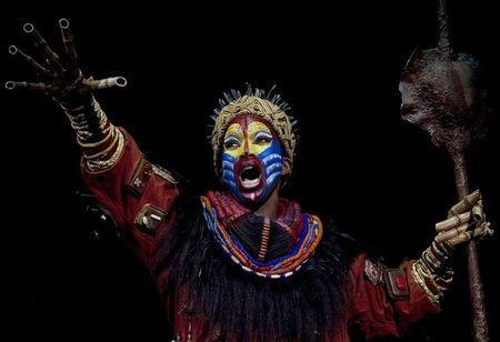 "Actress Brenda Mhlongo dressed as ""Rafiki"" performs during the press rehearsal of ""El Rey Leon"" (""The Lion King"") musical shows in Madrid October 13, 2011. REUTERS/Sergio Perez"