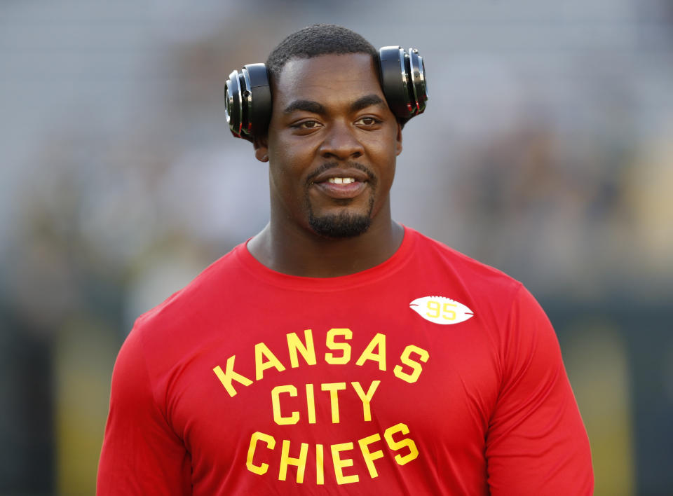 "Chris Jones with headphones and a red ""Kansas City Chiefs"" shirt."