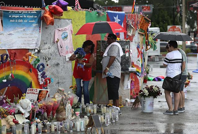 <p>People visit the memorial to the victims of the mass shooting setup around the Pulse gay nightclub one day before the one year anniversary of the shooting on June 11, 2017 in Orlando, Florida. (Joe Raedle/Getty Images) </p>