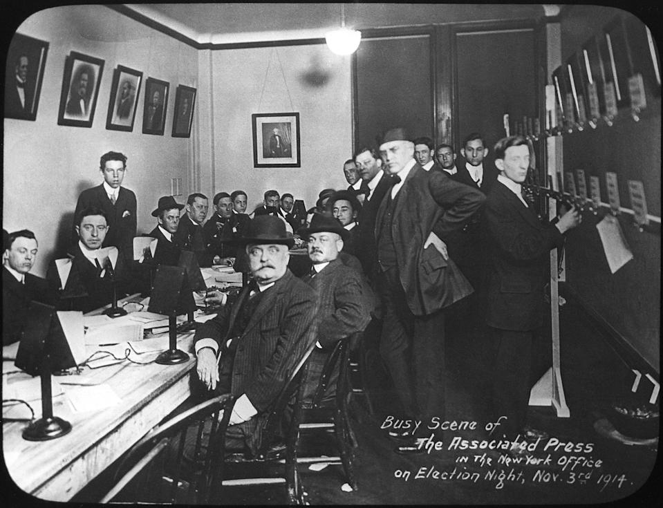 Workers crowd a room in the offices of The Associated Press in New York City on election night, Nov. 3, 1914. (AP Photo)