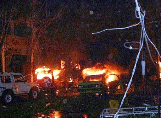 File photo taken in the early hours of October 13, 2002, shows vehicles and buildings in flames after deadly twin bomb attacks on a bar and nightclub in Kuta on Indonesia's resort island of Bali. The attacks triggered a long crackdown on terrorism in Indonesia, focused on weakening the Al-Qaeda-linked Jemaah Islamiyah (JI) terror network responsible for the bombings