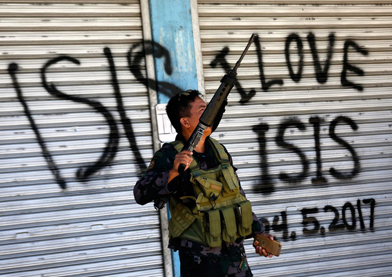 <p>A Filipino government troop conducts patrol on a reclaimed former Maute stronghold in Marawi City, Mindanao Island, southern Philippines on May 30, 2017, as fighting between Islamist militants and government forces continues. According to news reports, more than a 100 people have been killed in ongoing clashes between rebels and the Philippine army in Marawi in southern Philippines, a government spokesperson said. At least four rebels from the Maute group – with links to the so-called Islamic State (IS or ISIS, ISIL) – and two soldiers were killed on 30 May, government spokesperson Ernesto Abella, said in a press conference. Since the clashes broke out a week ago, the number of casualties has climbed to 104, including 19 civilians, 65 rebels, 17 soldiers and three police officers. The clashes began on 23 May when an army offensive to capture Isnilon Hapilon, leader of the terrorist group Abu Sayyaf, also loyal to the IS, and who was sheltered by members of the Maute group in Marawi, had failed. (Francis R. Malasig/EPA) </p>