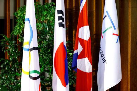 Flags of the International Olympic Committee, the Republic of Korea, the Democratic People's Republic of Korea, and the PyeongChang 2018 Organising Committee are seeing at the IOC headquarters in Lausanne