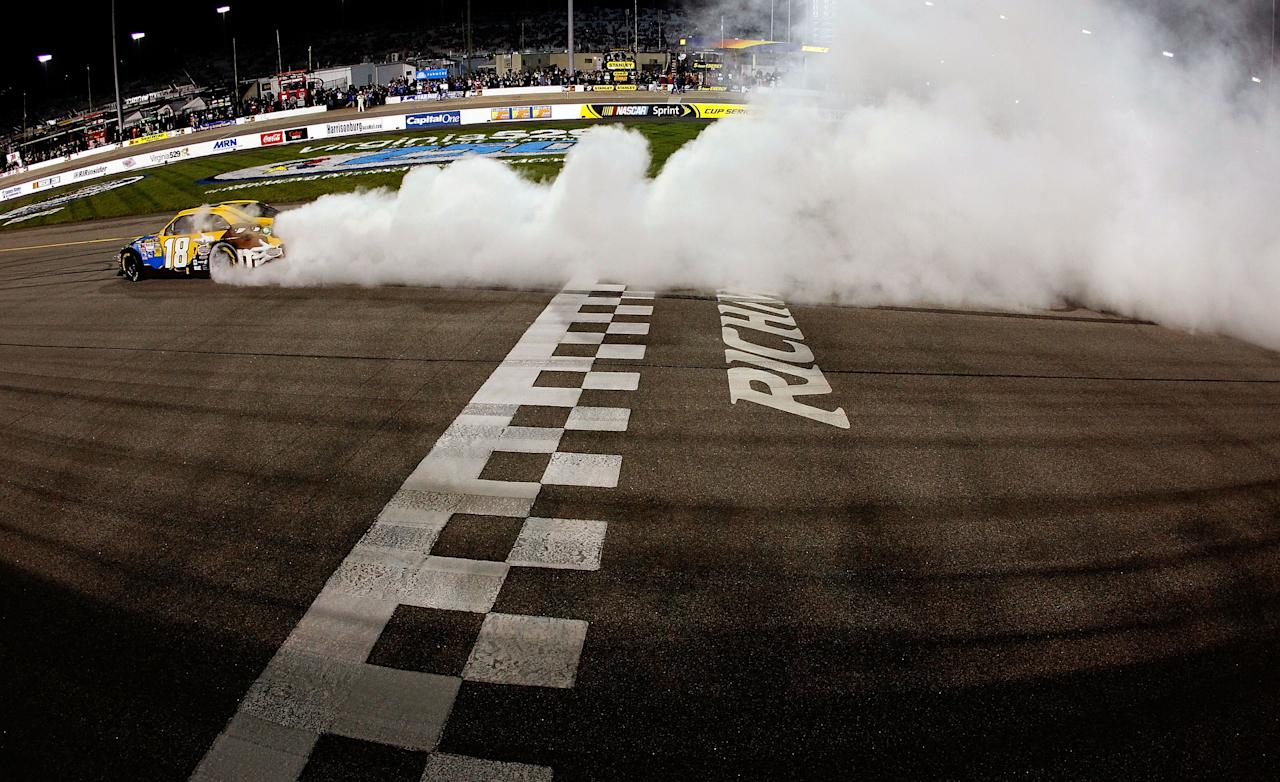 RICHMOND, VA - APRIL 28:  Kyle Busch, driver of the #18 M&M's Ms. Brown Toyota, celebrates with a burnout after winning the NASCAR Sprint Cup Series Capital City 400 at Richmond International Raceway on April 28, 2012 in Richmond, Virginia.  (Photo by Tom Pennington/Getty Images for NASCAR)