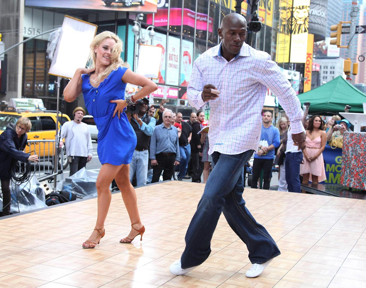 """NEW YORK, NY - MAY 23:  """"Dancing With The Stars"""" winners Peta Murgatroyd (L) and Donald Driver perform on ABC's """"Good Morning America"""" in Times Square on May 23, 2012 in New York City.  (Photo by Taylor Hill/Getty Images)"""