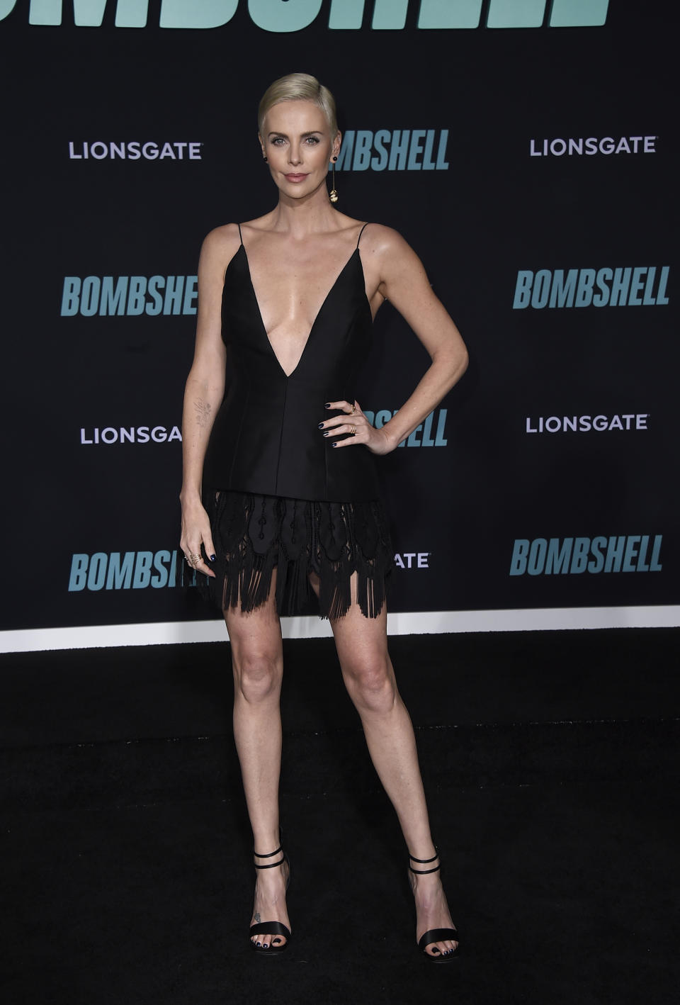 """Charlize Theron attends the premiere of """"Bombshell"""" at Regency Village Theatre on Tuesday, Dec. 10, 2019, in Los Angeles. (Photo by Jordan Strauss/Invision/AP)"""