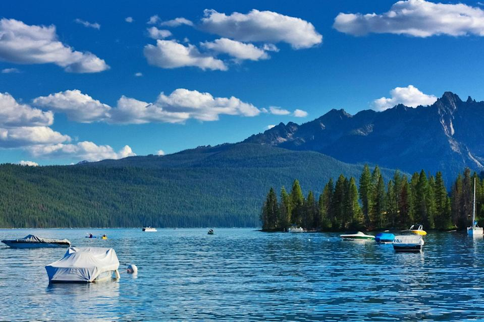 """<p><a href=""""https://redfishlake.com/"""" rel=""""nofollow noopener"""" target=""""_blank"""" data-ylk=""""slk:Redfish Lake"""" class=""""link rapid-noclick-resp"""">Redfish Lake</a> is nestled in central Idaho, high up in the Sawtooth Mountains. While there, you can stay in one of the comfortable cabins at Redfish Lake Lodge. It'll be like stepping back in time when the world moved at a slower place and you can enjoy the pristine lake waters and fresh mountain air.</p>"""