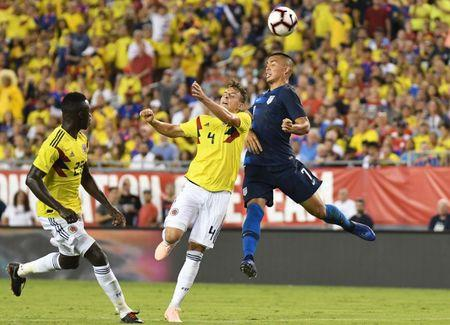 Oct 11, 2018; Tampa, FL, USA; United States forward Bobby Wood (7) and Columbia defender Santiago Arias (4) go for the ball  in the second half during an international friendly soccer match at Raymond James Stadium. Mandatory Credit: Jonathan Dyer-USA TODAY Sports