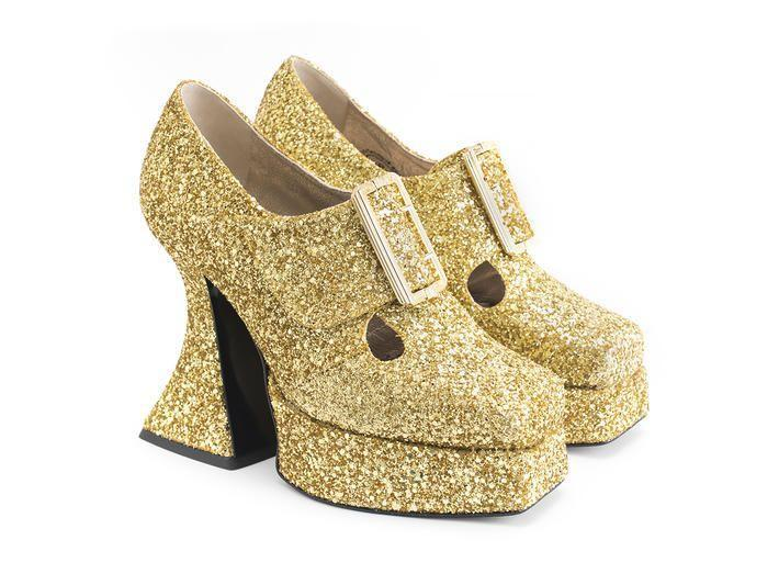 """<p><strong>John Fluevog</strong></p><p>fluevog.com</p><p><strong>$355.00</strong></p><p><a href=""""https://www.fluevog.com/shop/5621-original-gold?item=38&of=225"""" rel=""""nofollow noopener"""" target=""""_blank"""" data-ylk=""""slk:Shop Now"""" class=""""link rapid-noclick-resp"""">Shop Now</a></p><p>As the '80s and '90s club kid staple, John Fluevog is the pioneer of the ugly shoe. He still keeps the whimsy alive 50 years later with 28 stores worldwide. </p>"""