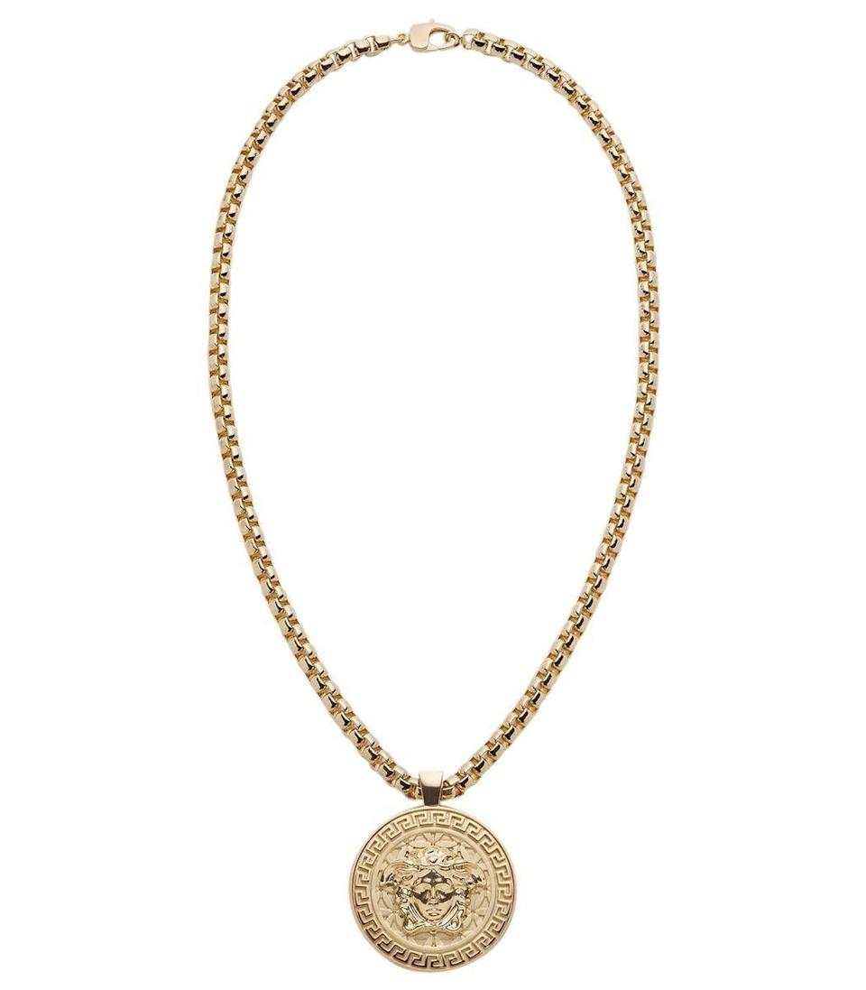 """<p><strong>Versace</strong></p><p>ShopBAZAAR.com</p><p><strong>$895.00</strong></p><p><a href=""""https://go.redirectingat.com?id=74968X1596630&url=https%3A%2F%2Fshop.harpersbazaar.com%2Fdesigners%2Fversace%2Fgold-tone-medusa-necklace-58690.html&sref=https%3A%2F%2Fwww.harpersbazaar.com%2Ffashion%2Ftrends%2Fg34644326%2Fholiday-jewelry%2F"""" rel=""""nofollow noopener"""" target=""""_blank"""" data-ylk=""""slk:Shop Now"""" class=""""link rapid-noclick-resp"""">Shop Now</a></p><p>Make your holiday at home feel like a trip to the Versace mansion with this pendant necklace. Or gift it: It makes the perfect find for anyone who loves a good logo. </p>"""