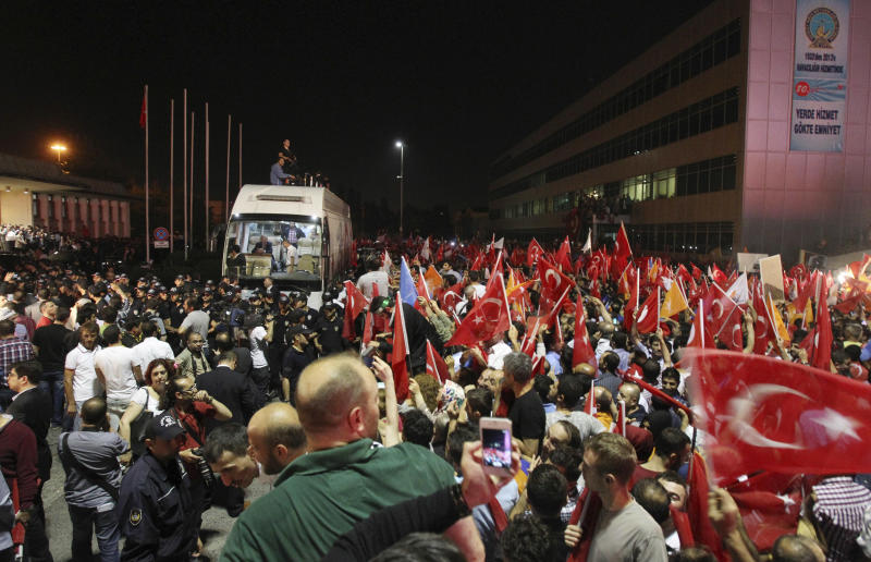 The crowd cheers for Turkish Prime Minister Recep Tayyip Erdogan's arrival at the Ataturk Airport of Istanbul early Friday, June 7, 2013. Erdogan took a combative stance on his closely watched return to the country early Friday, telling supporters who thronged to greet him that the protests that have swept the country must come to an end. (AP Photo/Thanassis Stavrakis)