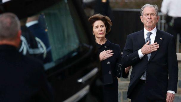 PHOTO: Former President George W. Bush and former first lady Laura Bush watch as the flag-draped casket of former President George H.W. Bush is carried to a State Funeral at the National Cathedral, Dec. 5, 2018 in Washington. (Alex Brandon/Pool via Getty Images)