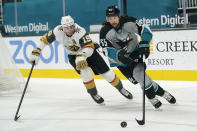 San Jose Sharks defenseman Erik Karlsson, right, skates in front of Vegas Golden Knights right wing Reilly Smith (19) during the second period of an NHL hockey game in San Jose, Calif., Saturday, March 6, 2021. (AP Photo/Jeff Chiu)