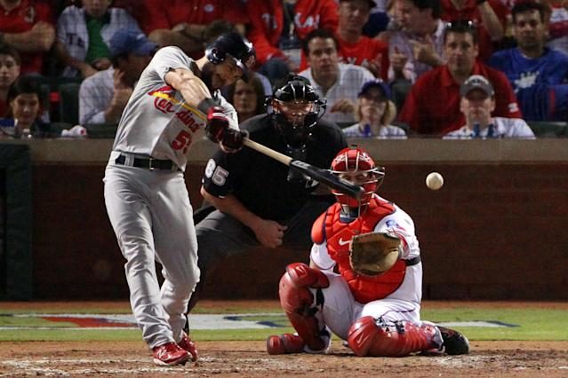 ARLINGTON, TX - OCTOBER 24: Skip Schumaker #55 of the St. Louis Cardinals hits a single to center field in the fifth inning during Game Five of the MLB World Series against the Texas Rangers at Rangers Ballpark in Arlington on October 24, 2011 in Arlington, Texas. (Photo by Doug Pensinger/Getty Images)