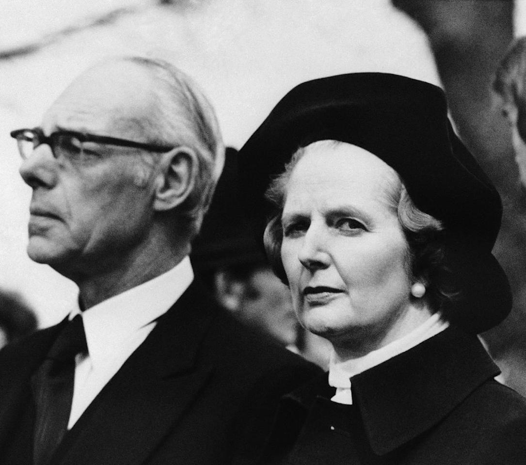 FILE - In a April 6, 1979 file photo, Margaret Thatcher, with husband Denis, attends the funeral of Airey Neave the Conservative Party leader's friend and political adviser, at ST. Mary's Church, in Longworth after Neave, Opposition spokesman on Northern Ireland, died when a terrorist bomb blasted his car in the Commons. Thatchers former spokesman, Tim Bell, said that former British Prime Minister Margaret Thatcher died Monday morning, April 8, 2013, of a stroke. She was 87. (AP Photo, File)