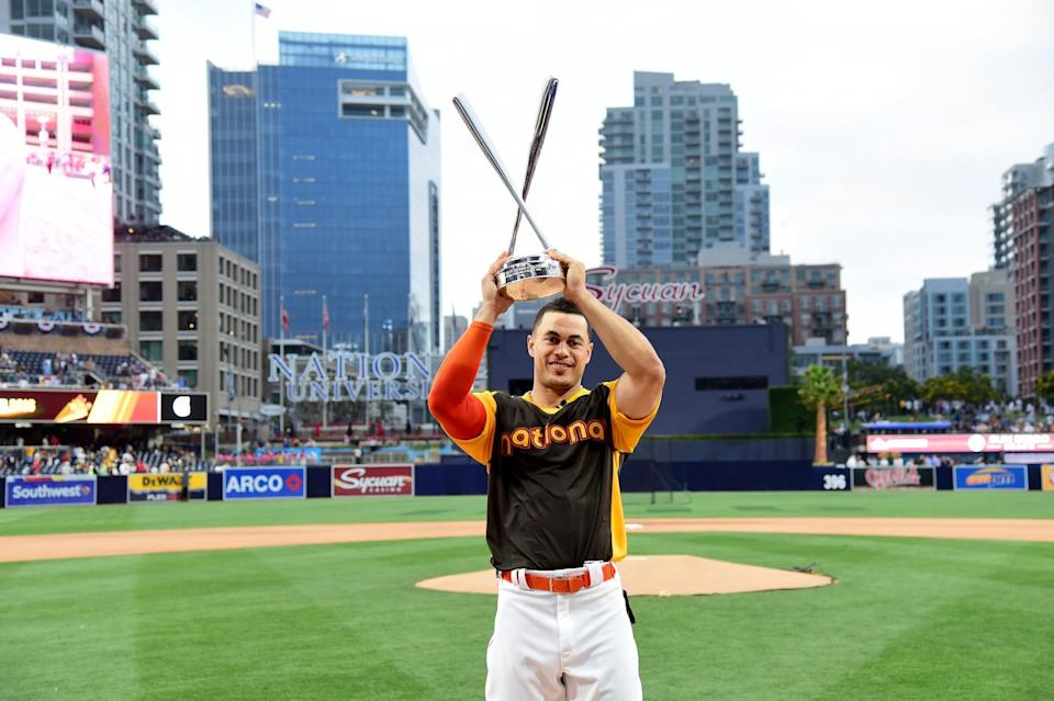 Giancarlo Stanton shows off his Home Run Derby trophy after mashing 61 homers. (Getty Images)