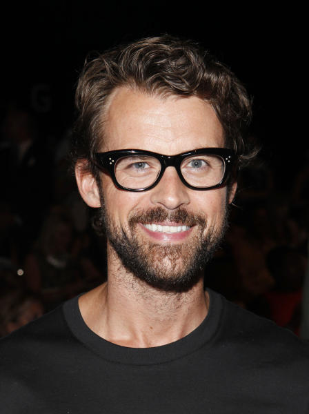 FILE - In this Sept. 11, 2013 file photo, Brad Goreski attends the J. Mendel Spring 2014 collection during Mercedes-Benz Fashion Week in New York. The flawless looks about to be unveiled on Oscar's red carpet on Sunday, March 2, 2014, have been months in the making and require an army of experts. Stylists scour the fashion shows in New York, London, Paris and Milan to find the freshest looks for Oscar's red carpet, says stylist Goreski. (Photo by Amy Sussman/Invision/AP, file)