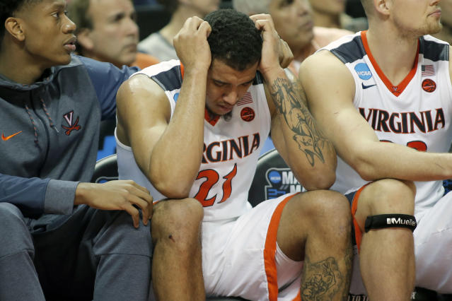 FILE - In this March 16, 2018, file photo, Virginia's Isaiah Wilkins (21) is consoled after fouling out during the second half of the team's first-round game against UMBC in the NCAA men's college basketball tournament in Charlotte, N.C. Virginia lost to UMBC 74-54. (AP Photo/Bob Leverone, File)