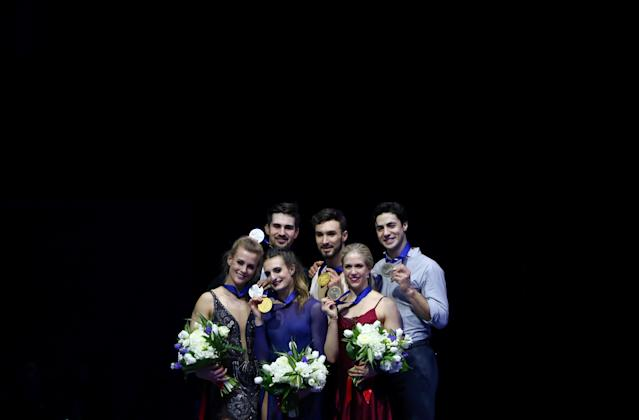 Figure Skating - World Figure Skating Championships - The Mediolanum Forum, Milan, Italy - March 24, 2018 France's Gabriella Papadakis and Guillaume Cizeron pose after winning the gold medal in the Ice Dance with second placed Madison Hubbell and Zachary Donohue of the U.S. and third placed Canada's Kaitlyn Weaver and Andrew Poje REUTERS/Alessandro Bianchi