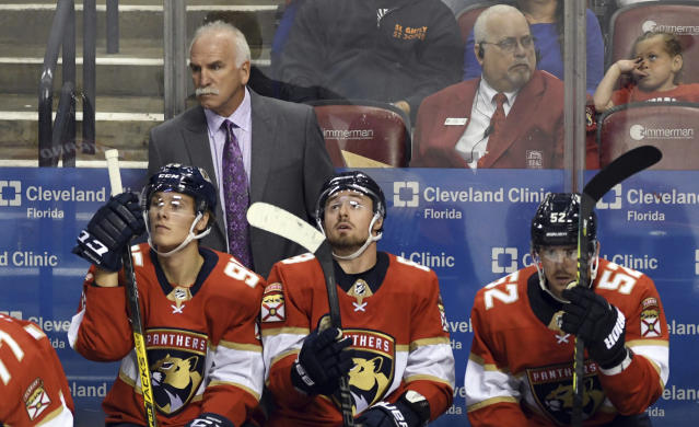 Florida Panthers head coach Joel Quenneville looks on against the Carolina Panthers during the third period of an NHL hockey game Tuesday, Oct. 8, 2019, in Sunrise, Fla. (AP Photo/Jim Rassol)