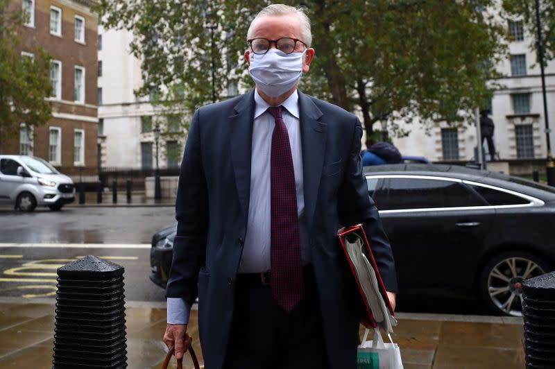FILE PHOTO: Britain's Chancellor of the Duchy of Lancaster Michael Gove arrives at the Cabinet Office in London