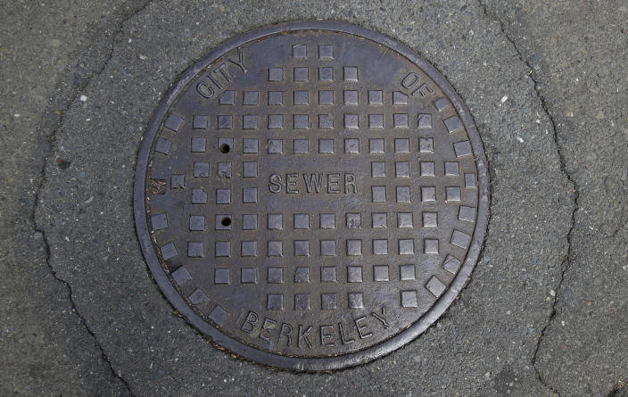 """A cover for a sewer is shown in an intersection in Berkeley, Calif., Thursday, July 18, 2019. There are no manholes in Berkeley, as city workers will drop into """"maintenance holes"""" instead. Nothing is manmade in the liberal city, it's """"human-made."""" Berkeley leaders voted unanimously this week to replace about 40 gender-specific words in the city code with gender-neutral terms. (AP Photo/Jeff Chiu)"""