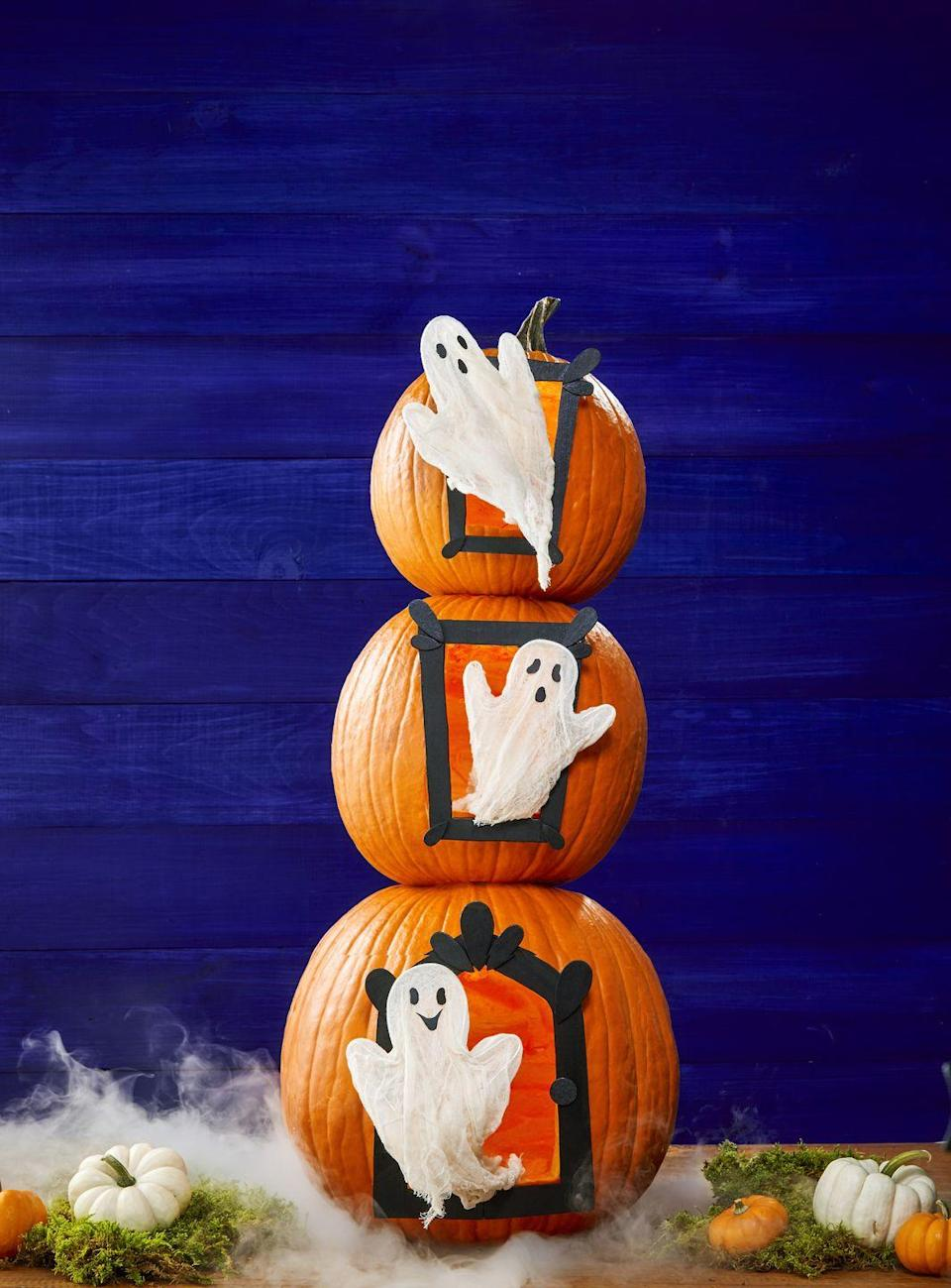 <p>Carve out doors on three pumpkins and have happy (or scary) ghosts pop out. You can even fill the pumpkins with fluff to look like smoke. </p>
