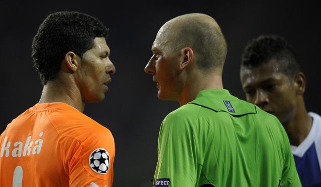 Apoel FC's Brazilian defender Kaka (L) argues with French referee Antony Gautier (C) close FC Porto's Colombian midfielder Fredy Guarin (R) during their UEFA Champions League Group G football match at the Dragao Stadium in Porto, on October 19, 2011. The match finished with a 1-1 draw. AFP PHOTO / MIGUEL RIOPA (Photo credit should read MIGUEL RIOPA/AFP/Getty Images)