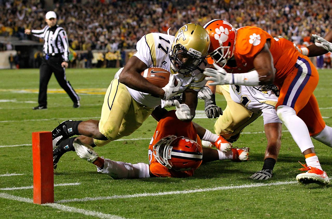 ATLANTA, GA - OCTOBER 29:  Orwin Smith #17 of the Georgia Tech Yellow Jackets scores a touchdown against Jonathan Willard #46 and Xavier Brewer #29 of the Clemson Tigers at Bobby Dodd Stadium on October 29, 2011 in Atlanta, Georgia.  (Photo by Kevin C. Cox/Getty Images)