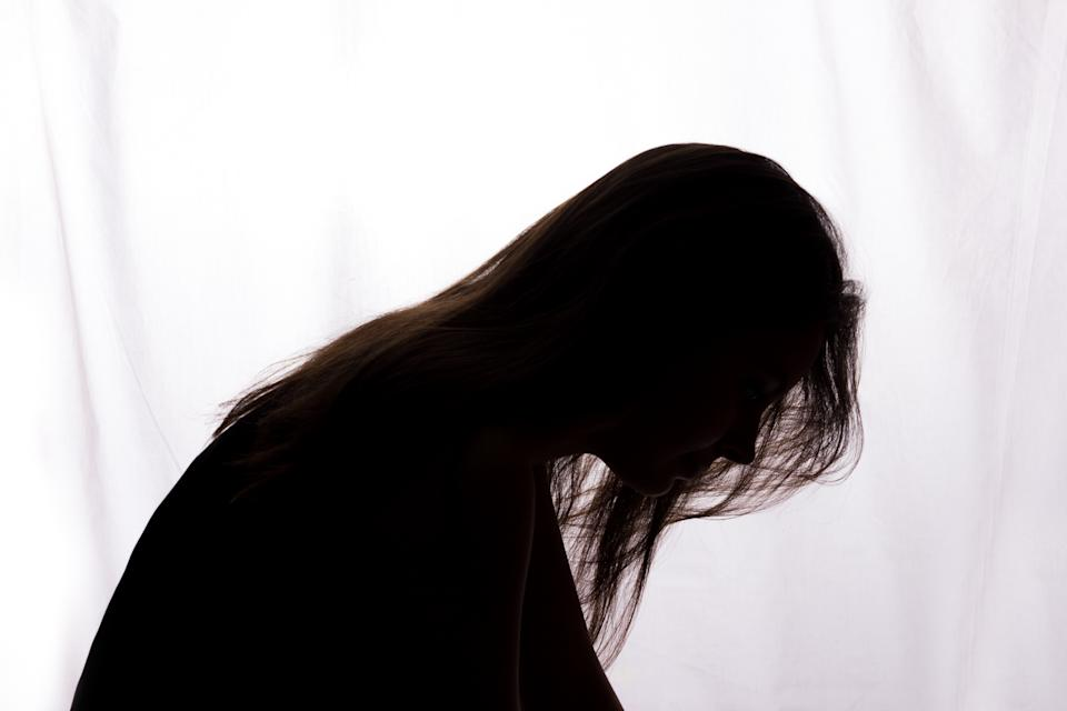 Silhouette of a young woman with problems - horizontal