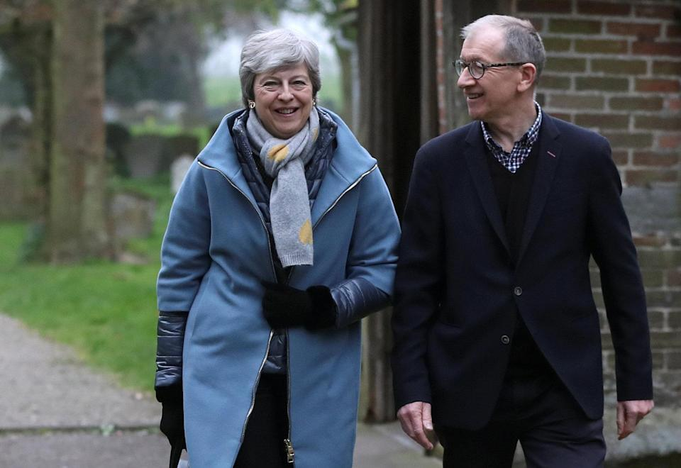 Britain's Prime Minister Theresa May and her husband Philip leave church, as Brexit turmoil continues, near High Wycombe, Britain April 7, 2019. REUTERS/Simon Dawson