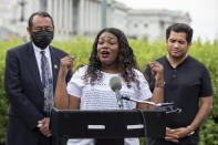 Rep. Cori Bush, D-Mo., flanked by Rep. Al Green, D-Texas, left, and Rep. Jimmy Gomez, D-Calif., right, speaks to the press after it was announced that the Biden administration will enact a targeted nationwide eviction moratorium outside of Capitol Hill in Washington on Tuesday, Aug. 3, 2021. For the past five days, lawmakers and activists primarily led by Rep. Cori Bush, D-Mo., have been sitting in on the steps of Capitol Hill to protest the expiration of the eviction moratorium. (AP Photo/Amanda Andrade-Rhoades)