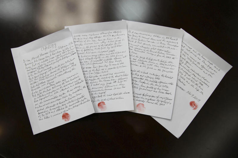 In this Nov. 9, 2013 photo released by the Korean Central News Agency (KCNA) and distributed Nov. 30, 2013 by the Korea News Service, hand written statements with red thumb prints, which North Korean authorities say is an apology written and read by 85-year-old U.S. citizen Merrill Newman, lie on a table in North Korea. Newman, an avid traveler and retired finance executive, was taken off a plane Oct. 26 by North Korean authorities while preparing to leave the country after a 10-day tour. (AP Photo/KCNA via KNS) JAPAN OUT UNTIL 14 DAYS AFTER THE DAY OF TRANSMISSION,