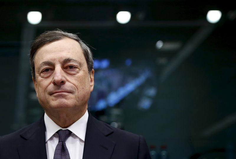 ECB President Draghi waits for the start of a eurozone finance ministers meeting in Brussels