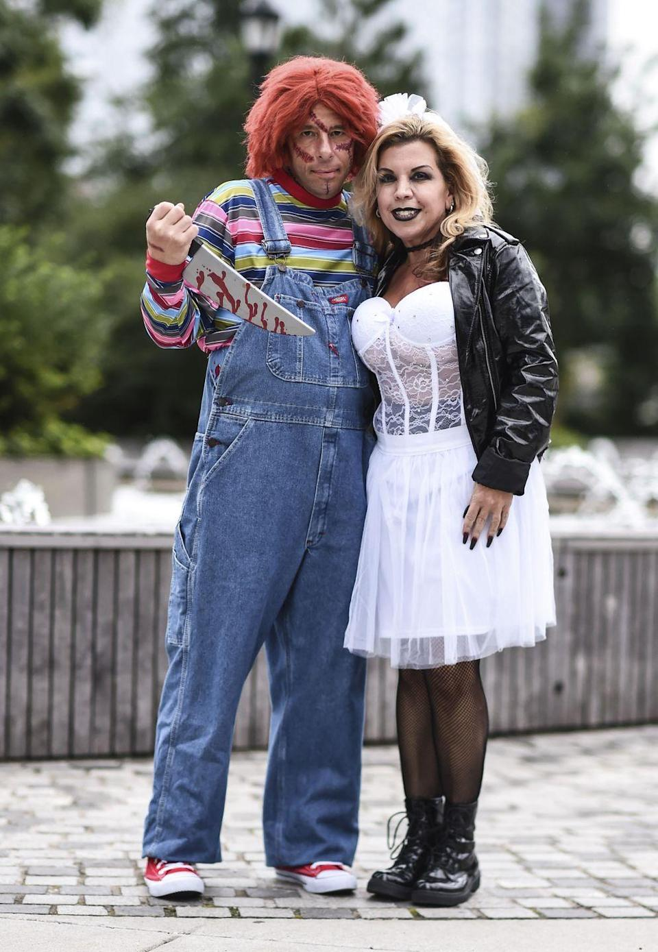 """<p>This costume is the perfect scary throwback, and you can make it your own with <a href=""""https://www.youtube.com/watch?v=xDeyoZbXwpQ"""" rel=""""nofollow noopener"""" target=""""_blank"""" data-ylk=""""slk:creepy makeup"""" class=""""link rapid-noclick-resp"""">creepy makeup</a> and the <a href=""""https://go.redirectingat.com?id=74968X1596630&url=https%3A%2F%2Fwww.walmart.com%2Fip%2FMorris-Costumes-Glow-in-the-Dark-Butcher-Knife-Halloween-Accessory%2F26980495&sref=https%3A%2F%2Fwww.womansday.com%2Fstyle%2Fg28669645%2Fscary-halloween-couples-costumes%2F"""" rel=""""nofollow noopener"""" target=""""_blank"""" data-ylk=""""slk:killer doll's signature butcher knife"""" class=""""link rapid-noclick-resp"""">killer doll's signature butcher knife</a>. Just remember to occasionally throw out the line, """"Hi, I'm Chucky! Wanna play?""""</p><p><a class=""""link rapid-noclick-resp"""" href=""""https://www.amazon.com/Franco-American-Novelty-Company-49582/dp/B074HS97FN/?tag=syn-yahoo-20&ascsubtag=%5Bartid%7C10070.g.28669645%5Bsrc%7Cyahoo-us"""" rel=""""nofollow noopener"""" target=""""_blank"""" data-ylk=""""slk:Shop Chucky Costume"""">Shop Chucky Costume</a></p><p><a class=""""link rapid-noclick-resp"""" href=""""https://www.amazon.com/Bride-Chucky-Adult-Costume-Large/dp/B00BLMVZSW/?tag=syn-yahoo-20&ascsubtag=%5Bartid%7C10070.g.28669645%5Bsrc%7Cyahoo-us"""" rel=""""nofollow noopener"""" target=""""_blank"""" data-ylk=""""slk:Shop Bride of Chucky Costume"""">Shop Bride of Chucky Costume</a><br> </p>"""