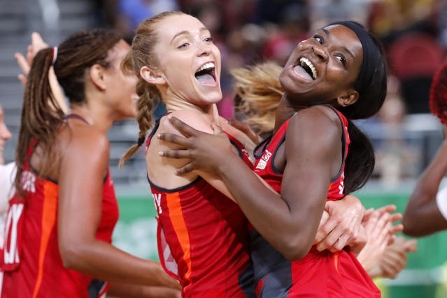 England's Helen Housby, left, and Jodie Gibson celebrate victory (AP Photo/Mark Schiefelbein)