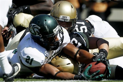 Sacramento State running back A.J. Ellis, front, stretches to score a touchdown as Colorado defensive back Parker Orms, center, and defensive lineman Justin Solis cover in the first quarter of an NCAA college football game in Boulder, Colo., Saturday, Sept. 8, 2012. (AP Photo/David Zalubowski)
