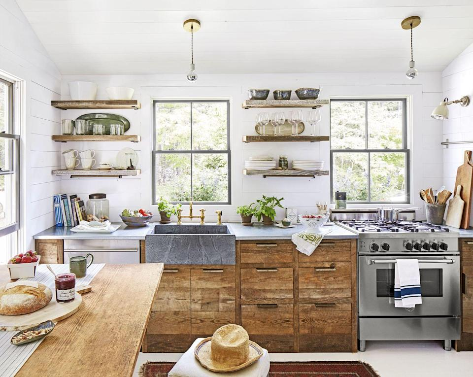 "<p>You don't have to go nuts to achieve an on-trend kitchen. While an apron-front sink in a farmhouse kitchen isn't exactly unexpected, a farmhouse sink in soapstone with brass hardware is a showstopper—especially when it's set against white walls, wood cabinets, and stainless steel countertops.</p><p><a class=""link rapid-noclick-resp"" href=""https://www.amazon.com/10-Pack-702-4BB-Contemporary-Hardware/dp/B0745H5PWH?ref_=fsclp_pl_dp_6&tag=syn-yahoo-20&ascsubtag=%5Bartid%7C10050.g.3988%5Bsrc%7Cyahoo-us"" rel=""nofollow noopener"" target=""_blank"" data-ylk=""slk:SHOP BRASS HARDWARE"">SHOP BRASS HARDWARE </a></p>"