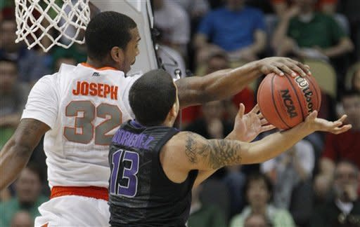 Syracuse's Kris Joseph (32) blocks a shot by Kansas State's Angel Rodriguez (13) in the first half of an NCAA tournament third-round college basketball game, Saturday, March 17, 2012 in Pittsburgh. (AP Photo/Keith Srakocic)