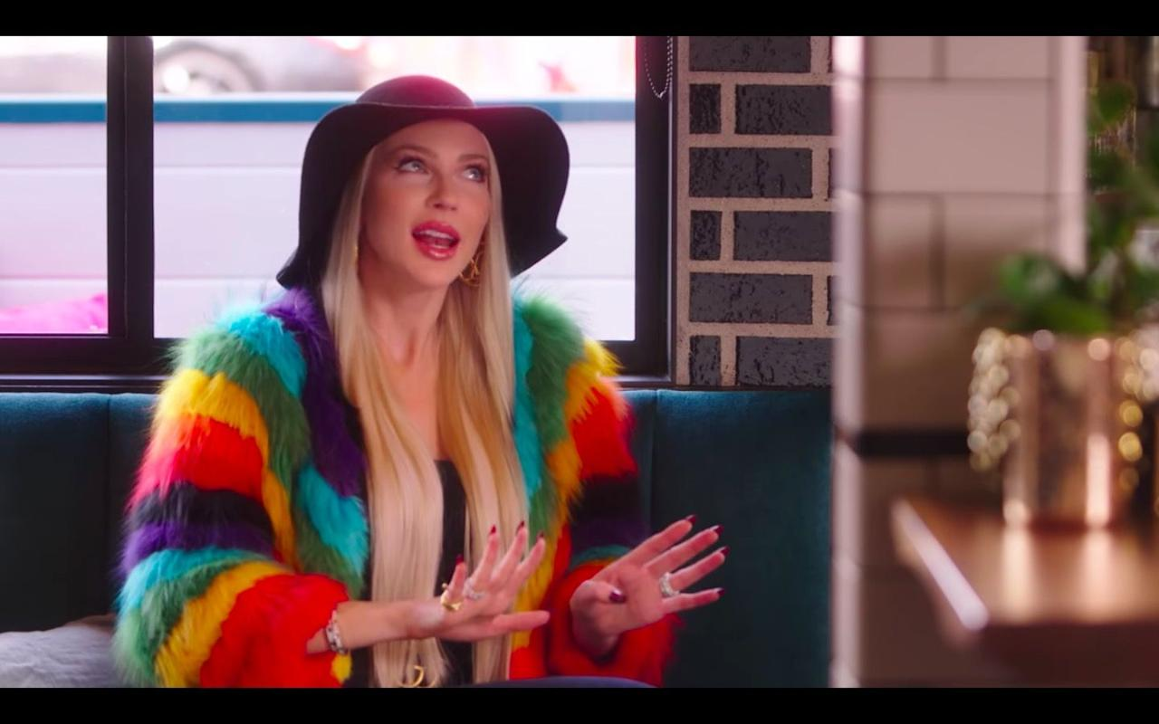 <p>Christine met Mary for a coffee catchup in this super casual getup. Her felt hat had feathers hanging from the back, and her rainbow jacket was accessorised with a bright yellow handbag. LA, am I right? </p>