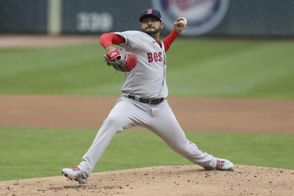 Boston Red Sox' Martín Pérez throws against the Minnesota Twins during the first inning of a baseball game, Tuesday, April 13, 2021, in Minneapolis. (AP Photo/Stacy Bengs)