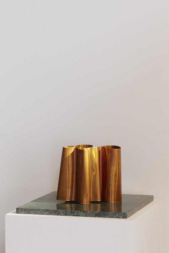 """These wavy tabletop lights by Danish design duo Lumière Bricoleur look more like snazzy art installations than living room fixtures, but they find their humble origins in the streets and scrapyards of Copenhagen. Created from salvaged copper, each piece is made by hand and is unique (and therefore fully customizable), and they give off a cozy, bonfire-like glow when turned on. Trash has never looked so chic. $489, Lumiere Bricoleur. <a href=""""https://www.lumierebricoleur.com/shop/kobberlampe"""" rel=""""nofollow noopener"""" target=""""_blank"""" data-ylk=""""slk:Get it now!"""" class=""""link rapid-noclick-resp"""">Get it now!</a>"""