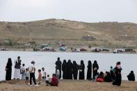 People gather during an excursion at a dam in Sayyan near Sanaa