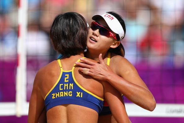 LONDON, ENGLAND - JULY 30:  Xi Zhang of China and Chen Xue of China celebrate during their Women's Beach Volleyball Preliminary match between China and Switzerland on Day 3 of the London 2012 Olympic Games at Horse Guards Parade on July 30, 2012 in London, England.  (Photo by Ryan Pierse/Getty Images)