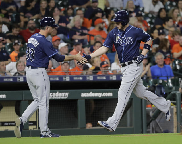 Tampa Bay Rays' C.J. Cron, right, is congratulated by third base coach Matt Quatraro (33) after hitting a home run against the Houston Astros during the second inning of a baseball game Tuesday, June 19, 2018, in Houston. (AP Photo/David J. Phillip)