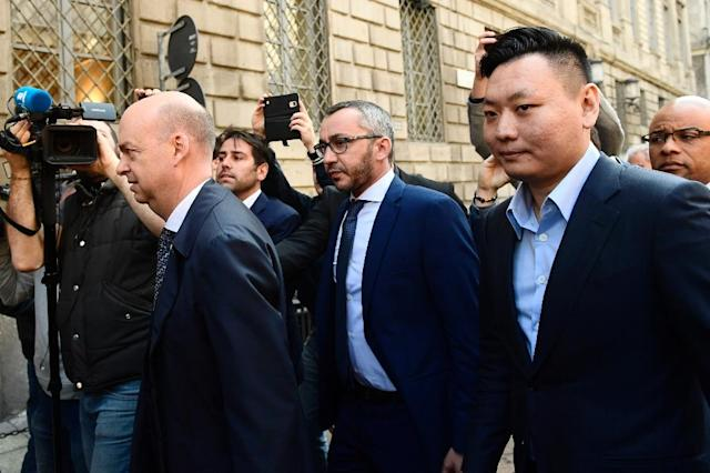 Han Li (R) and Marco Fassone (L), representatives of Chinese consortium Sino-Europe Sports (SES), arrive in Milan to finalize the deal with Fininvest for AC Milan's takeover by Rossoneri Sport Investment Lux on April 13, 201 (AFP Photo/Miguel MEDINA)